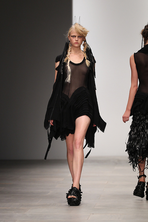 Models walk the catwalk for the John Rocha show during the Spring 2012 London Fashion Week.