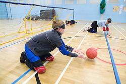 Winger Team Player  throwing the ball during a Goalball game; a threeaside game developed for the visually impaired and played on a volleyball court, A specially adapted ball containing an internal bell is used,