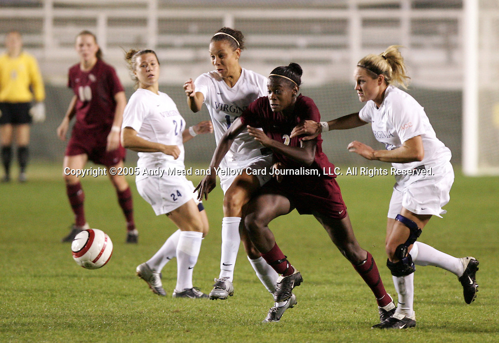 Florida State's India Trotter (2) tries to fight her way through Virginia's Kelly Hammond (r), Jess Rostedt (12), and Kelly Quinn (24) on Friday, November 4th, 2005 at SAS Stadium in Cary, North Carolina. The University of Virginia Cavaliers defeated the Florida State University Seminoles 2-0 in their Atlantic Coast Conference Tournament Semifinal game.