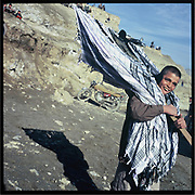 A young scarf seller in the outskirts of Kabul.