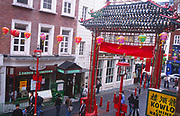 AWFP60 Large arches at entrance to  Chinatown Soho London England