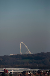 """© Licensed to London News Pictures. 19/01/2017. London, UK. The arch of Wembley Stadium is seen as a thick layer of """"toxic"""" smog is hangs over central London, blown in from continental Europe, as seen from Northala Fields in west London.  Following the announcement by the Mayor of London ofof higher than normal pollution levels, Londoners have been urged to protect their health. Photo credit : Stephen Chung/LNP"""