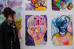 """© Licensed to London News Pictures. 21/10/2020. LONDON, UK. Artist Daniella Kammerer next to her work """"Skin around the head"""", 2020. Preview of STARTnet Art Fair at the Saatchi Gallery in Chelsea.  The contemporary art fair showcases local London, as well as international, galleries and individual artists from all over the world.  The fair runs 21 to 25 October with Covid-19 protocols in place for visitors.   Photo credit: Stephen Chung/LNP"""