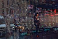 Namrata Brar of New Delhi TV on air in the Nasdaq studio in Times Square. ..Photo by Robert Caplin.