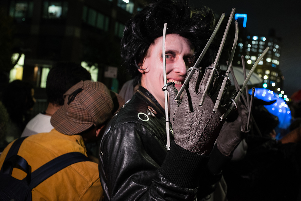 New York, NY - 31 October 2019. the annual Greenwich Village Halloween Parade along Manhattan's 6th Avenue. A man costumed as Edward Scissorhands.