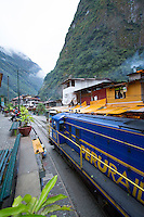 Aguas Calientes is a town in Peru on the Urubamba (Vilcanota) River. It is the closest access point to the sacred Incan city of Machu Picchu which is 6 kilometers away. The town has natural hot springs, which give its name (hot waters in Spanish).