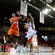 Anadolu Efes's Stephane Lasme (R) and istanbul BSB's Alexander Maurice (L) during their Turkish Basketball League match Anadolu Efes between istanbul BSB at Abdi Ipekci Arena in Istanbul Turkey on Sunday 16 November 2014. Photo by Aykut AKICI/TURKPIX