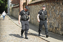 Police officers walk near to York Minister ahead of the wedding of singer Ellie Goulding to Caspar Jopling.