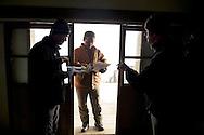 Checking permits at the 369 Lodge.