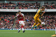 Hector Bellerin Of Arsenal shoots as Solly March of Brighton and Hove Albion ® tries to block.<br /> Premier league match, Arsenal v Brighton & Hove Albion at the Emirates Stadium in London on Sunday 1st October 2017. pic by Kieran Clarke, Andrew Orchard sports photography.