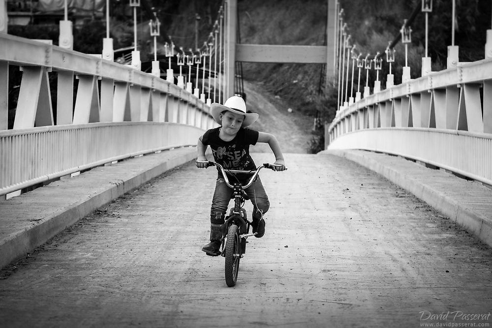 Riding on the bridge.