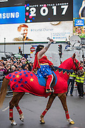 Wonderwoman rides a hosrse through Piccadilly Circus - The New Years day parade passes through central London form Piccadilly to Whitehall. London 01 Jan 2017