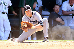 14 April 2013:  Luke Collins fields a throw to first for an out during an NCAA division 3 College Conference of Illinois and Wisconsin (CCIW) Baseball game between the Elmhurst Bluejays and the Illinois Wesleyan Titans in Jack Horenberger Stadium, Bloomington IL
