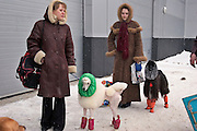 Moscow, Russia, 25/02/2006..Exhibitors make their way through a snowstorm to the Eurasian Dog Show, the largest in Russia, with some 9,000 entrants.