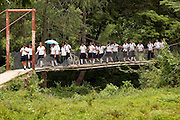 School children make their way across a bridge after leaving school at 12pm in Guaimaca, Honduras.   Honduras is considered the third poorest country in the Western Hemisphere (Haiti, Nicaragua). With over 50% of the population living below the poverty line and 28% unemployed, Hondurans frequently turn to illegal immigration as a solution to their desperate situation. The Department of Homeland Security has noted an 95% increase in illegal immigrants coming from Honduras between 2000 and 2009, the largest increase of any country.