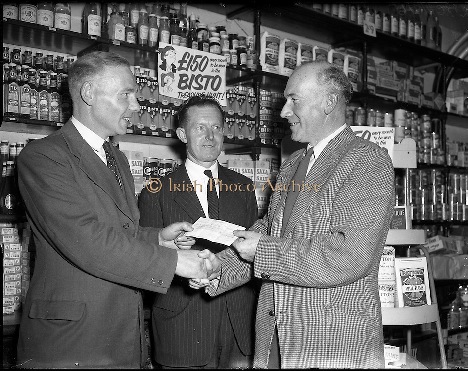 04/11/1955<br /> 11/04/1955<br /> 04 November 1955<br /> Cerebos special presentation for Bisto competition winner at Monaghan for McConnell's. Gentleman being presented with his winning cheque.
