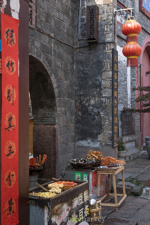 View of a street food stall in an old Chinese town, Fenghuang, Hunan Province, China