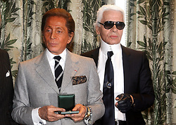 Italy's veteran designer Valentino poses for a picture with designer Karl Lagerfeld after Paris Mayor Bertrand Delanoe awarded Valentino with a medal honouring his lifetime achievement in Paris, France on January 24, 2008. Valentino's final farewell to fashion was the emotional high point of the haute couture shows in the spring-summer which started 21 January. Photo by Mousse/ABACAPRESS.COM