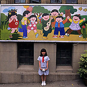 China, Student in front of Children's Palace School in Shanghai.