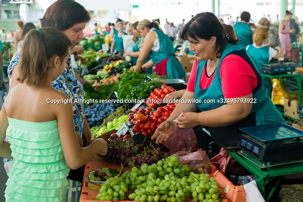 20150828  Moldova, Transnistria,Pridnestrovian Moldavian Republic (PMR) The green market entrance. The green market is a place in the center of Tiraspol where people sell their goods,This woman sells vegetables, and all saleswomen wear green.