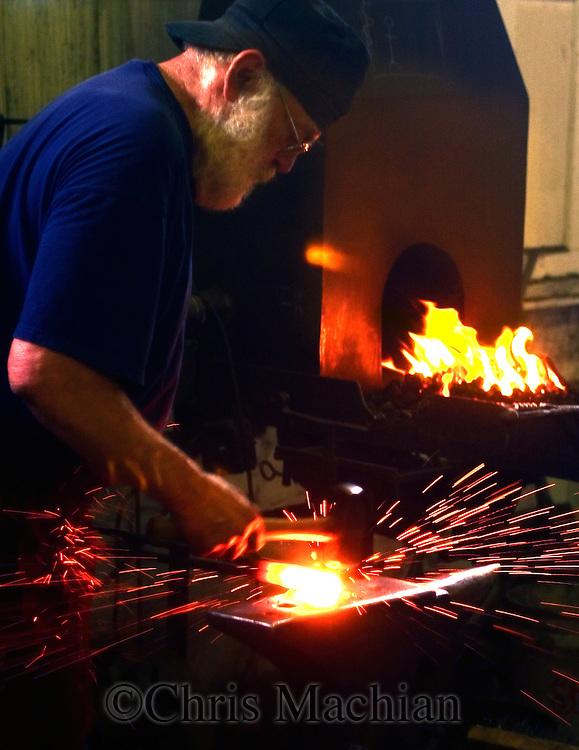 John Loken of the Loken forge at the hot shops. (photo by chris machian) 5/18/05  Omaha, NE The Hot Shops Art Gallery..(photo by Chris Machian/Prarie Pixel Group)