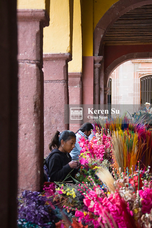 Woman selling flowers on the street,  San Miguel de Allende, Mexico