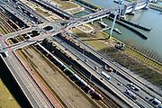 Nederland, Zuid-Holland, Rotterdam, 18-02-2015. A15 ter hoogte van het Hartelkruis. Goederentrein op Betuweroute richting Maasvlakte II.<br /> Motorway A15 and freight railway, connecting Port of Rotterdam with hinterland.<br /> luchtfoto (toeslag op standard tarieven);<br /> aerial photo (additional fee required);<br /> copyright foto/photo Siebe Swart