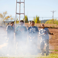 101112       Brian Leddy<br /> Wingate Rocket Club students Colten Pine, Nathan Wilson, Jerek Begay and Trinity Charlie watch their rocket shoot into the air during a launch Thursday. The club celebrated New Mexico's 100th birthday and Native American week with the launching of a rockets, singing and dancing.