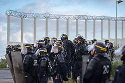 October 1, 2016 - Calais, France - French anti-riot police are pictured during clashes with participants during a march in support of migrants and refugees in the so-called 'Jungle' camp in the French northern port city of Calais on October 1, 2016...Between 7,000 and 10,000 migrants are currently living in the ''Jungle'', the launchpad for their attempts to stow away on lorries heading across the Channel to England. Rights groups have criticised the hardship and dangers facing the migrants living in the camp, particularly the hundreds of unaccompanied minors. (Credit Image: © Julien Mattia/NurPhoto via ZUMA Press)