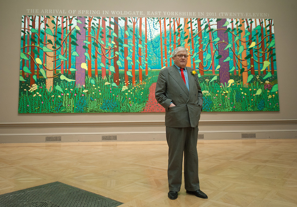 """David Hockney stands in front of his painting called """" The arrival of Spring in Woldgate in East Yorkshire 2011 at The RAA on January 16th 2011...Photo Ki Price."""