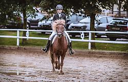 THEMENBILD - eine junge Reiterin mit ihrem Islandpferd bei einer Reitprüfung am Reiterhof Burghauser, aufgenommen am 31. August 2018 in Strasswalchen, Österreich // a young girl with her Icelandic horse during a riding test at the Reiterhof Burghauser, Strasswalchen, Austria on 2018/08/31. EXPA Pictures © 2018, PhotoCredit: EXPA/ JFK