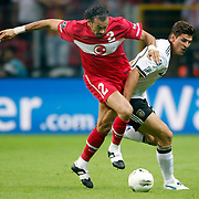 Turkey's Servet CETIN (L) during their UEFA EURO 2012 Qualifying round Group A matchday 19 soccer match Turkey betwen Germany at TT Arena in Istanbul October 7, 2011. Photo by TURKPIX