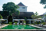 View of the Riverside Boutique Resort and its pool,  Vang Vieng, Laos.