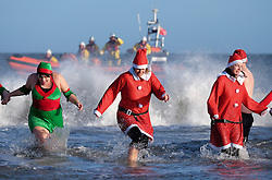 © Licensed to London News Pictures. <br /> 26/12/2016. <br /> Redcar, UK.  <br /> <br /> Hundreds of people run into the cold waters of the North sea as they take part in the annual Boxing Day dip at Redcar beach.<br /> <br /> The event which attracts many hardy souls each Boxing day morning, many wearing fancy dress, helps to raise hundreds of pounds for a wide range of local and national charities.<br /> <br /> <br /> Photo credit: Ian Forsyth/LNP