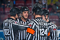 KELOWNA, CANADA - NOVEMBER 14: Referees Steve Papp and Ward Pateman stand at centre ice with linesmen Dustin Minty and Kevin Crowell as the Edmonton Oil Kings visit the Kelowna Rockets on November 14, 2017 at Prospera Place in Kelowna, British Columbia, Canada.  (Photo by Marissa Baecker/Shoot the Breeze)  *** Local Caption ***
