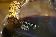 La Garance in a decanter from Torres. The cork tied in a sting around the neck of the decanter. Domaine de la Garance. Pezenas region. Languedoc. Wine aerating in a carafe. France. Europe.