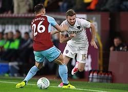 Burnley's Phil Bardsley (left) and Leeds United's Stuart Dallas battle for the ball during the Carabao Cup, third round match at Turf Moor, Burnley.