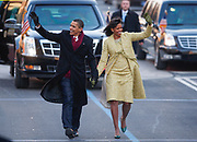 U.S. President Barack Obama and his wife Michelle walk the parade route after being sworn in after the inauguration ceremony in Washington, January 20, 2009.<br /> Reuters/Jim Young