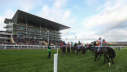 Runners gather at the start for the Pertemps Network Handicap hurdle race during day two of the Showcase at Cheltenham Racecourse