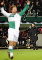 Photo: Paul Thomas.<br /> Werder Bremen v Chelsea. UEFA Champions League, Group A. 22/11/2006.<br /> <br /> A dejected Chelsea manager, Jose Mourinho, at the final whistle, while Bremen celebrate.
