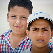 Ashraf and Hasan, two of Borg-Meghezil's children on the beach where the River Nile passes their village, just before it enters the Mediterranean Sea.