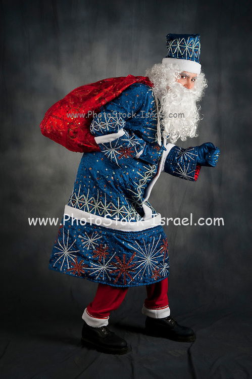 The Russian version of Father Christmas known as Ded Moroz (literally Grandfather Frost) plays the same role as Santa Claus Here with bag of gifts
