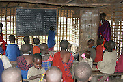 Africa, Tanzania, Lake Eyasi, young Maasai children learning arithmetic in a school room an ethnic group of semi-nomadic people February 2006