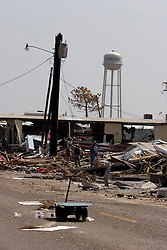 26 Sept, 2005. Cameron, Louisiana. Hurricane Rita aftermath. <br /> The destroyed remains of  downtown business in Cameron, Louisiana two days after the storm ravaged the small town. The water tower was one of the few structures to survive the storm.<br /> Photo; ©Charlie Varley/varleypix.com