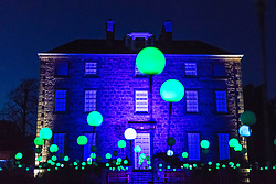 Edinburgh, Scotland, United Kingdom. 24 November, 2017. Edinburgh's newest festive event, Christmas at the Botanics, opened this evening . The illuminations held inside Edinburgh's Royal Botanic Gardens runs for 29 nights. Inverleith House with spheres of light in the Bloom display.