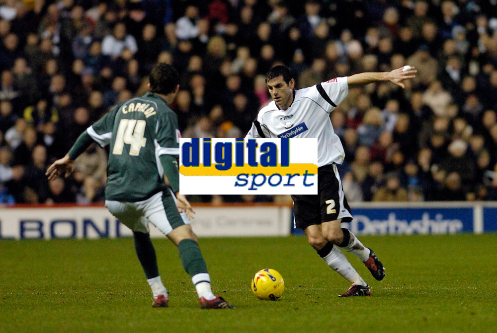 Photo: Leigh Quinnell.<br /> Derby County v Plymouth Argyle. Coca Cola Championship. 30/12/2006. Derbys Marc Edworthy looks for a way past Plymouths Tony Capaldi.