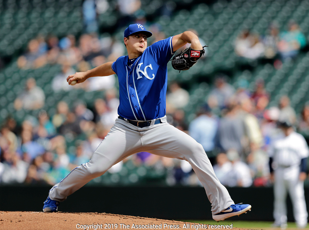 Kansas City Royals starting pitcher Brad Keller works against the Seattle Mariners duringthe first inning of  a baseball game, Wednesday, June 19, 2019, in Seattle. (AP Photo/John Froschauer)