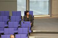 17 OCT 2003, BERLIN/GERMANY:<br /> Ulla Schmidt, SPD, Bundesgesundheitsministerin, sitzt allein in einer der letzten Reihe der FDP-Fraktion, waehrend einer Bundestagsdebatte, Plenum, Deutscher Bundestag<br /> IMAGE: 20031017-01-133