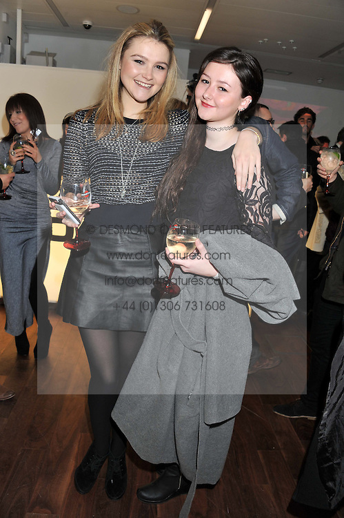 Left to right, AMBER ATHERTON and her sister YASMIN ATHERTON at a party to celebrate the launch of the Casio Tokyo watch in association with Flashtrash.com held at itsu, 10a Blandford Road, London W1 on 28th January 2013.