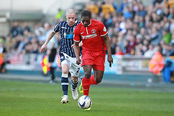 Charlton Athletic's Marvin Sordell is chased by Millwall's Alan Dunne - Photo mandatory by-line: Robin White/JMP - Tel: Mobile: 07966 386802 15/03/2014 - SPORT - FOOTBALL - The Den - Millwall - Millwall v Charlton Athletic - Sky Bet Championship